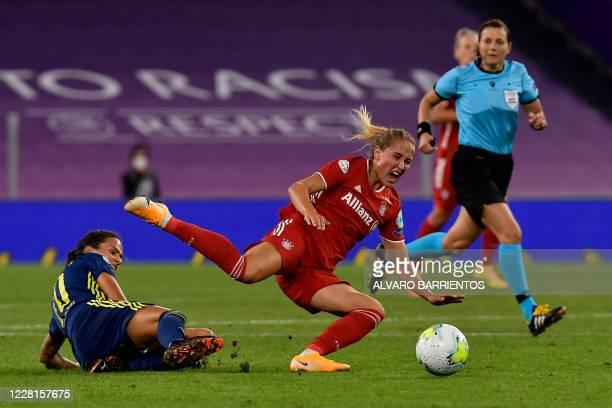 Lyon's German midfielder Dzsenifer Marozsan vies with Bayern Munich's German midfielder Sydney Lohmann during the UEFA Women's Champions League...