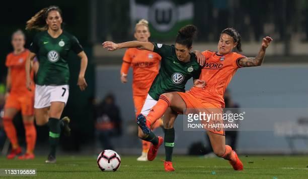 Lyon's German midfielder Dzsenifer Marozsan vies with Wolfsburg's Portugese midfielder Claudia Neto during the UEFA women's Champions League...