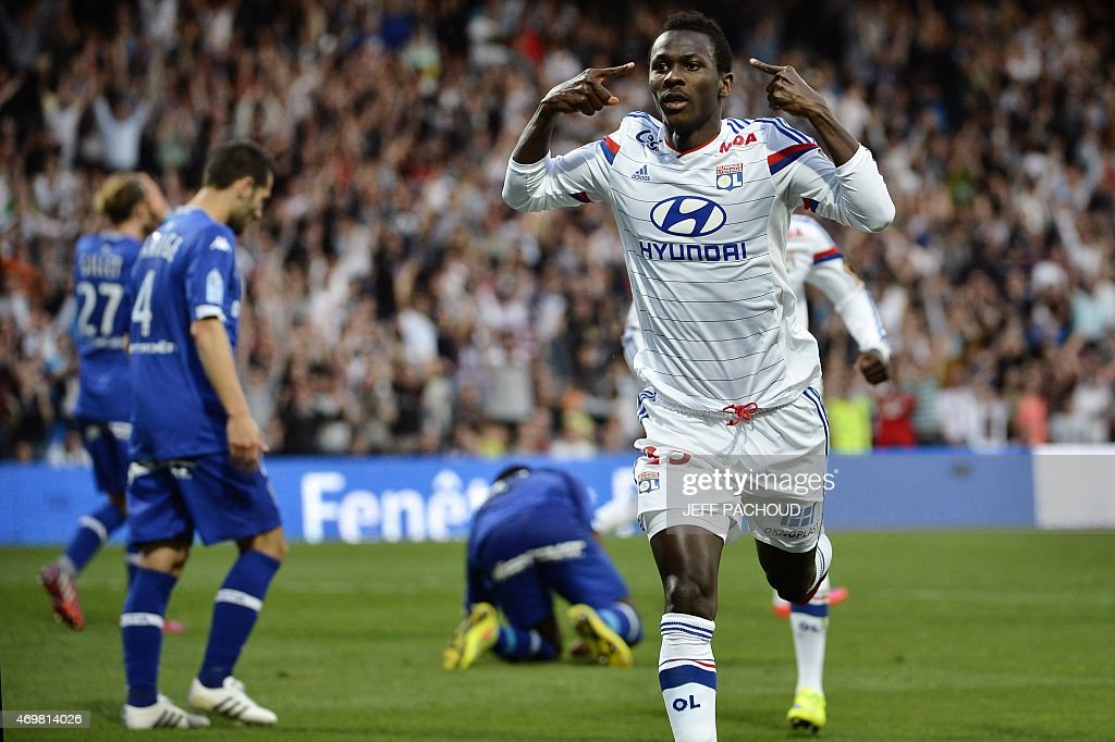 Lyon's Guinean forward Mohamed Yattara (R) celebrates after scoring a goal during the French L1 football match Olympique Lyonnais (OL) vs SC Bastia (SCB) on April 15, 2015, at the Gerland Stadium in Lyon, central-eastern France.