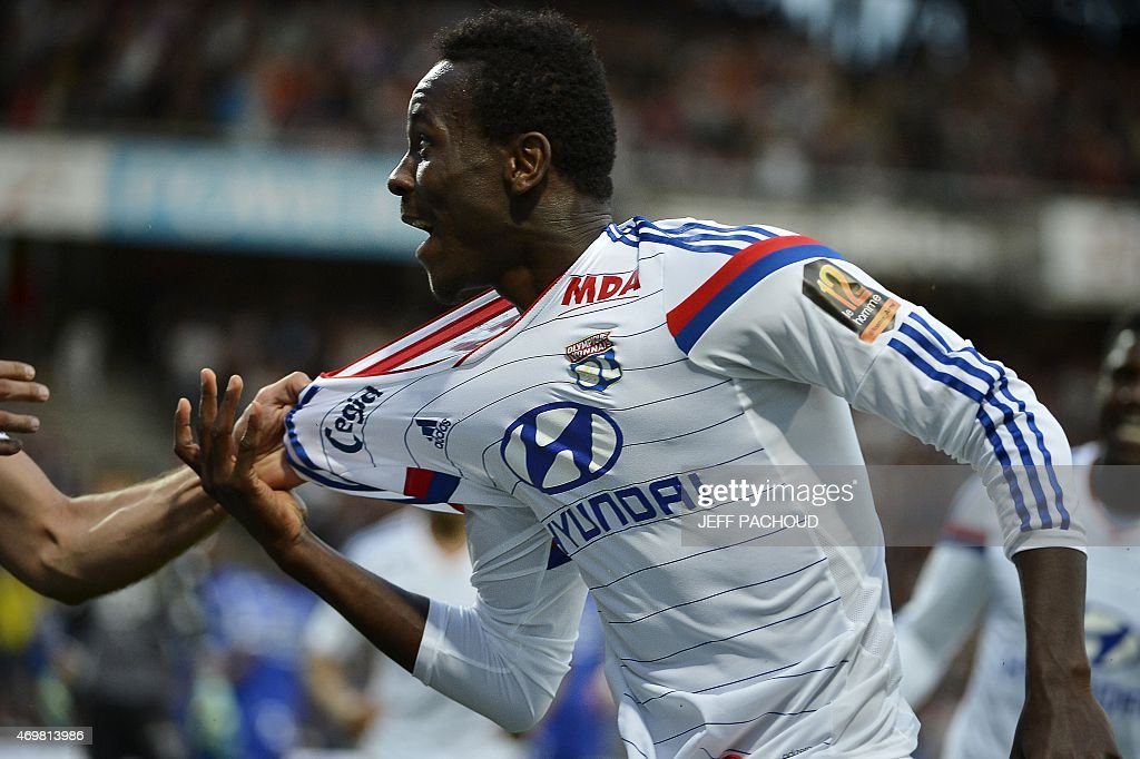 Lyon's Guinean forward Mohamed Yattara (R) celebrates with his teammates after scoring a goal during the French L1 football match Olympique Lyonnais (OL) vs SC Bastia (SCB) on April 15, 2015, at the Gerland Stadium in Lyon, central-eastern France.