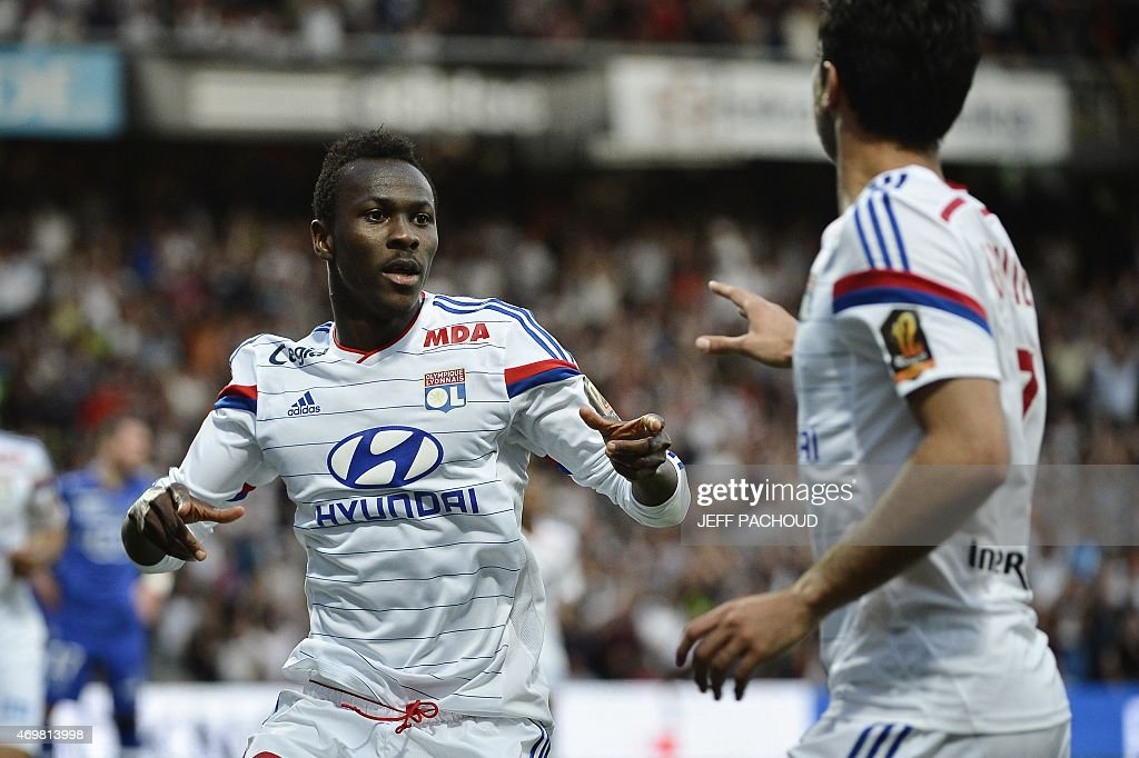 Lyon's Guinean forward Mohamed Yattara (L) celebrates with his teammates after scoring a goal during the French L1 football match Olympique Lyonnais (OL) vs SC Bastia (SCB) on April 15, 2015, at the Gerland Stadium in Lyon, central-eastern France.