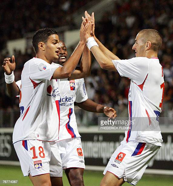 Lyon's Hatem Ben Arfa congratules forward Karim Benzema after he scored the second goal during their French L1 football match 15 September 2007 at...