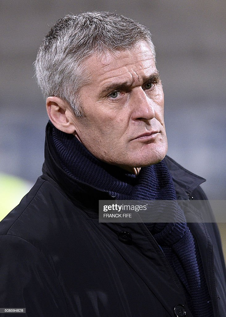 Lyon's head coach Gerard Precheur looks on during the French Women's D1 football match between Paris Saint-Germain (PSG) AND Lyon (OL) at Charlety stadium in Paris on February 5, 2016. / AFP / FRANCK