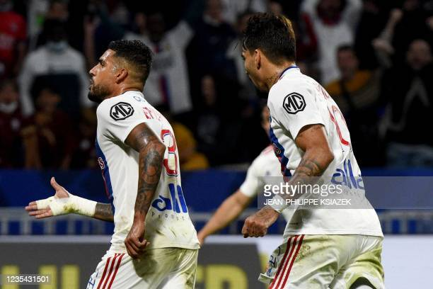 Lyon's Italian defender Emerson Palmieri celebrates after scoring a goal during the French L1 football match between Lyon and Troyes in...