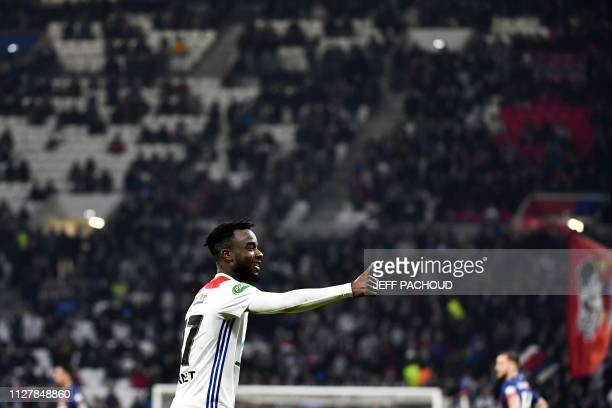 Lyon's Ivorian forward Maxwel Cornet celebrates after scoring a goal during the French Cup football match Olympique Lyonnais vs SM Caen on February...