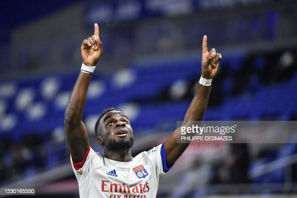 Lyon's Ivorian forward Maxwel Cornet celebrates after scoring a goal during the French L1 football match between Olympique Lyonnais and Le Stade...