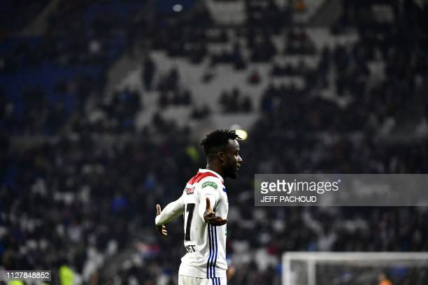 Lyon's Ivorian forward Maxwell Gnaly Cornet celebrates after scoring during the French Cup quarterfinal football match between Olympique Lyonnais and...