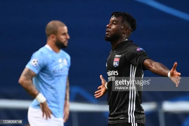 Lyon's Ivorian forward Maxwel Cornet celebrates his goal during the UEFA Champions League quarter-final football match between Manchester City and...