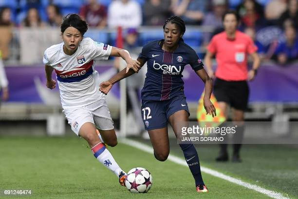 Lyon's Japanese defender Saki Kumagai vies with Paris SaintGermain's Canadian midfielder Ashley Lawrence during the UEFA Women's Champions League...