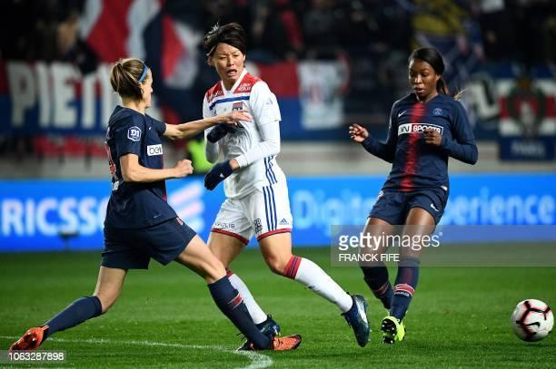 Lyon's Japanese midfielder Saki Kumagai vies with Paris Saint-Germain's Spanish defender Irene Paredes during the French Women's D1 football match...
