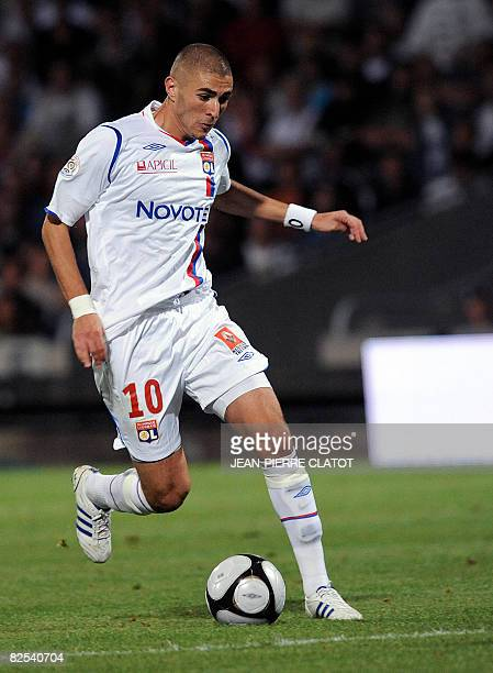 Lyon's Karim Benzema dribbles the ball during the French L1 football match Lyon vs Grenoble on August 23 2008 at the Gerland stadium in Lyon central...