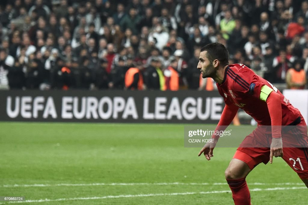 Lyon's Maxime Gonalons celebrates his team's victory at the end of the UEFA Europa League second leg quarter final football match between Besiktas and Lyon (OL) on April 20, 2017, near the Vodafone arena stadium in Istanbul. /