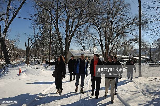 Lyons mayor Julie Van Domelen, left, points out flood damage to, from left to right, Colorado state senator Mark Udall, governor John Hickenlooper,...