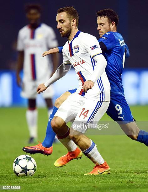 Lyon's midfielder Sergi Darder vies with Dinamo's midfielder Angelo Henriquez during the UEFA Champions League Group H football match between GNK...
