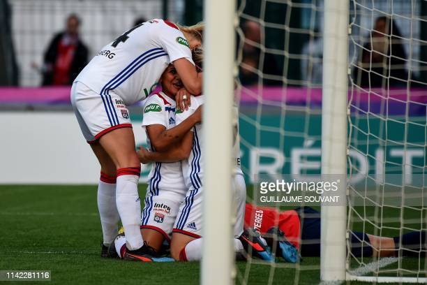 Lyon's Netherland forward Shanice Van De Sanden celebrates with teammates Lyon's Norvegian forward Ada Hegerberg and Lyon's French forward Eugenie Le...