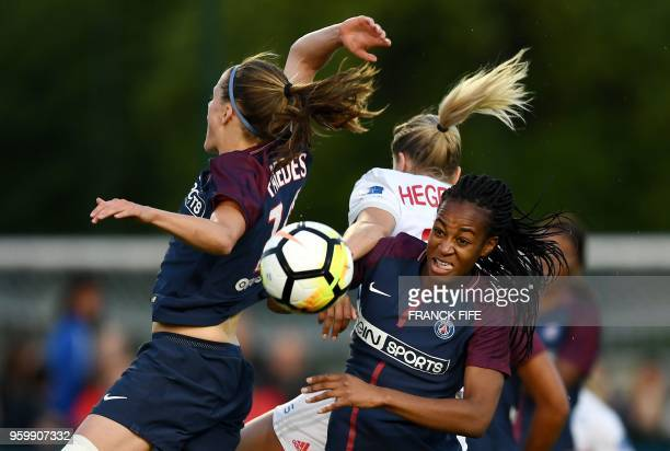 Lyons Norway forward Ada Hegerberg and Paris SaintGermain's French forward Marie Antoinette Katoto head the ball during the French D1 Women's...