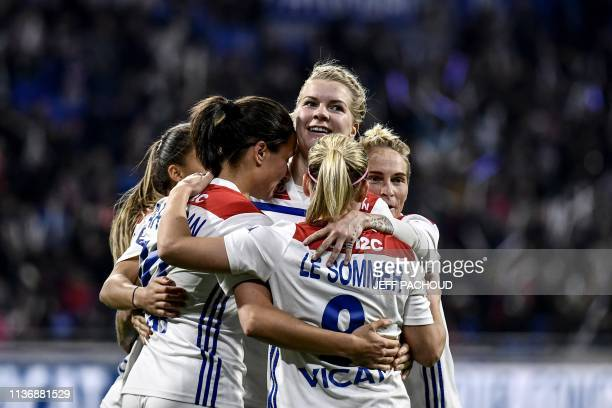Lyon's Norwegian forward Ada Hegerberg celebrates with team mates after Lyon's French midfielder Dzsenifer Marozsan scored a goal during the French...