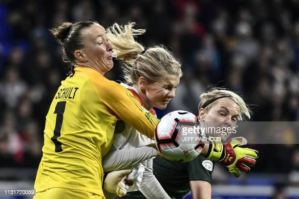 Lyon's Norwegian forward Ada Hegerberg vies for the ball with Wolfsburg's German goakeeper Almuth Schult and Wolfsburg's Swedish defender Nilla...