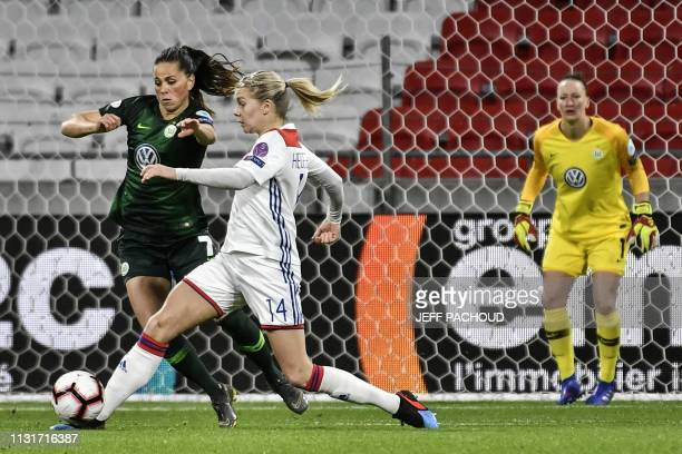 Lyon's Norwegian forward Ada Hegerberg vies with Wolfsburg's Icelandic midfielder Sara Bjork GunnarsDottir during the UEFA women's Champions League...