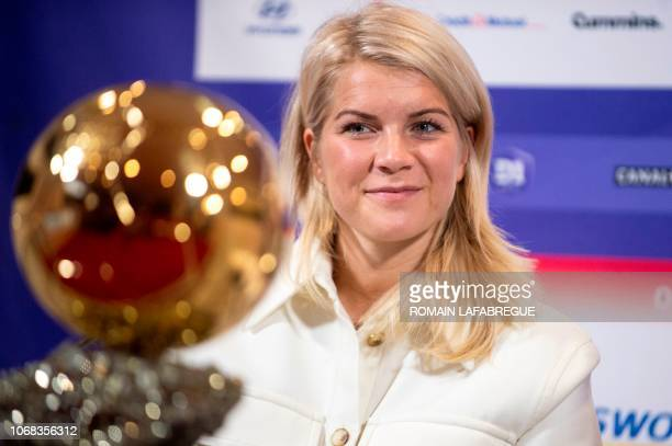 Lyon's Norwegian forward Ada Hegerberg winner of 2018 Women's Ballon d'Or award for best player of the year poses with the trophy during a press...