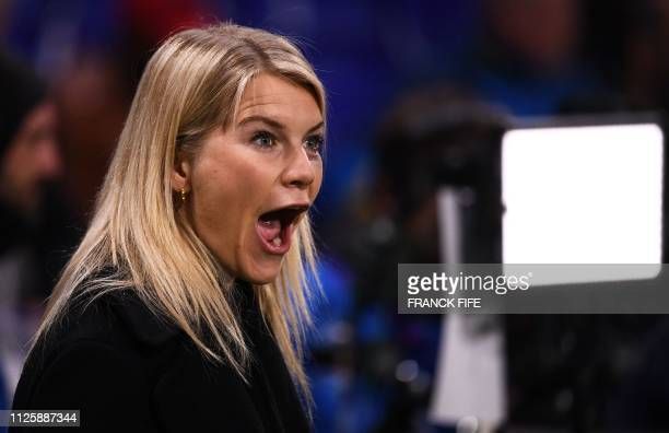 Lyon's Norwegian forward Ada Hegerberg winner of 2018 Women's Ballon d'Or award for best player of the year reacts prior to the UEFA Champions League...