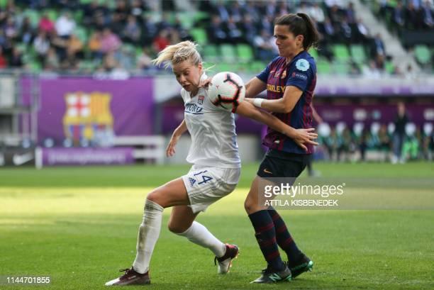 Lyon's Norwegian striker Ada Hegerberg aand Barcelona's Spanish defender Andrea Pereira vie for the ball during the UEFA Women's Champions League...