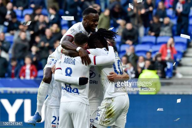 Lyon's players celebrate after Lyon's Burkinabe forward Bertrand Traore scored a goal during the French L1 football match between Lyon and Strasbourg...