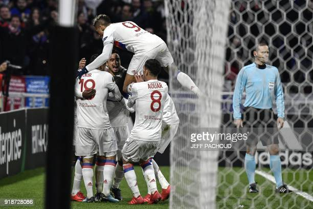 Lyon's players celebrate after Lyon's French midfielder Tanguy NDombele scored a goal during the UEFA Europa League football match between Olympique...