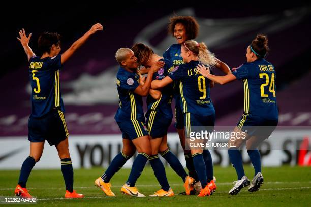 Lyon's players celebrate after Lyon's Icelandic midfielder Sara Bjork Gunnarsdottir scored the 3-1 goal during the UEFA Women's Champions League...