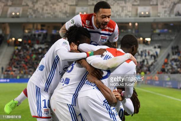 Lyon's players celebrate after scoring a goal during the French L1 football match between Bordeaux and Lyon on April 26 2019 at the Matmut Atlantique...