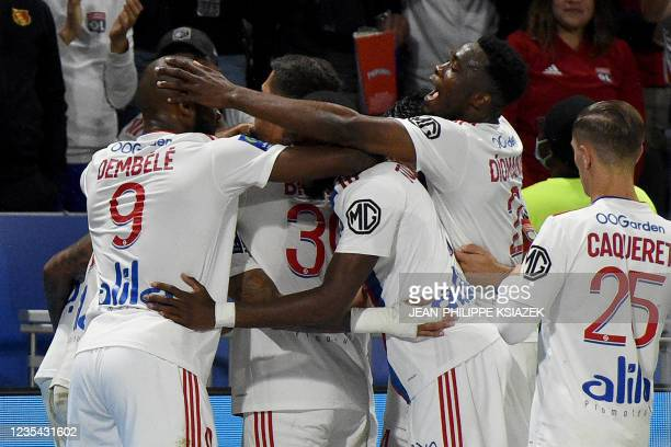 Lyon's players celebrate after scoring a goal during the French L1 football match between Lyon and Troyes in Decines-Charpieu, on September 22, 2021.
