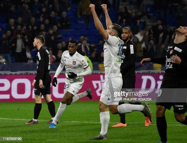 Lyon's players celebrate after scoring a goal during the French League Cup quarterfinal football match between Olympique Lyonnais and Stade Brestois...