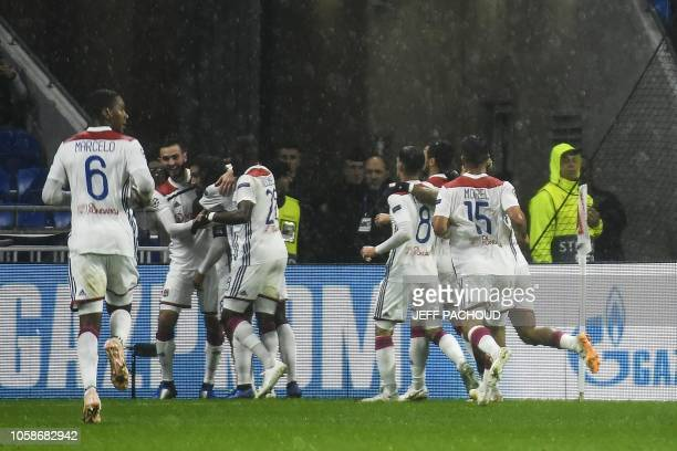Lyon's players celebrate after scoring the opener during the UEFA Champions League Group F football match between Olympique Lyonnais and TSG 1899...