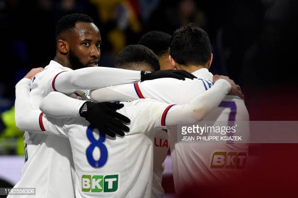 Lyon's players celebrate after scoring their second goal during the French League Cup quarterfinal football match between Olympique Lyonnais and...