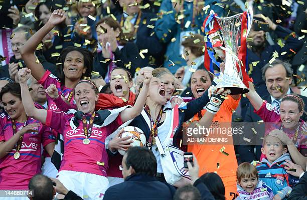 Lyon's players celebrate after winning the UEFA Women's Champions League final football match of Olympique Lyonnais vs 1 FFC Frankfurt at the...