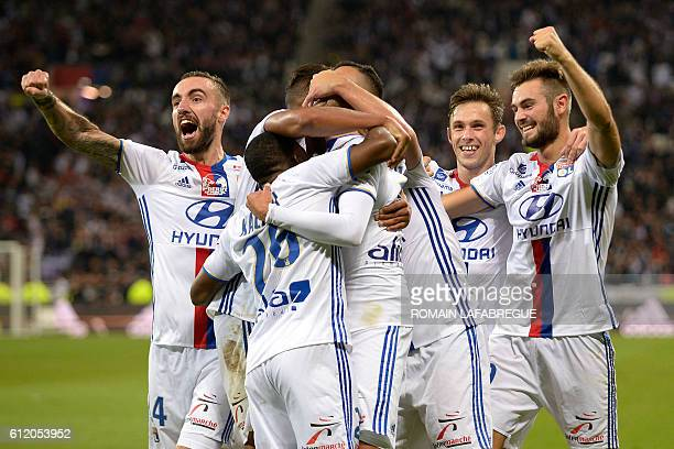 Lyon's players celebrate at the end of the French L1 football match between Lyon and AS SaintEtienne at the Parc Olympique Lyonnais in...