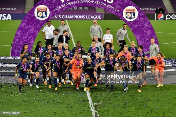 Lyon's players celebrate at the end of the UEFA Women's Champions League final football match between VfL Wolfsburg and Lyon at the Anoeta stadium in...