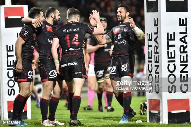 Lyon's players celebrate during the French Top 14 rugby union match between Lyon and Stade Francais on April 14 2018 at the Matmut stadium in Lyon...