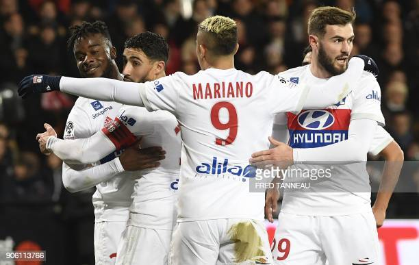 Lyon's players celebrate the goal by Nabil Fekir during the French L1 football match between Guingamp and Lyon at the Roudourou Stadium in Guingamp...