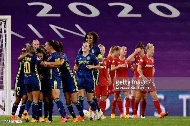 Lyon's players celebrate their a second goal scored by Lyon's French midfielder Amel Majri during the UEFA Women's Champions League quarter-final...