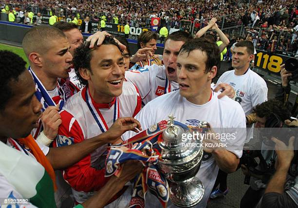 Lyon's players celebrate with the trophy after beating Paris during their French Cup final football match Paris vs. Lyon on May 24, 2008 at the Stade...