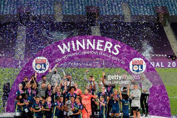 Lyon's players celebrate with the trophy winning the UEFA Women's Champions League final football match between VfL Wolfsburg and Lyon at the Anoeta...