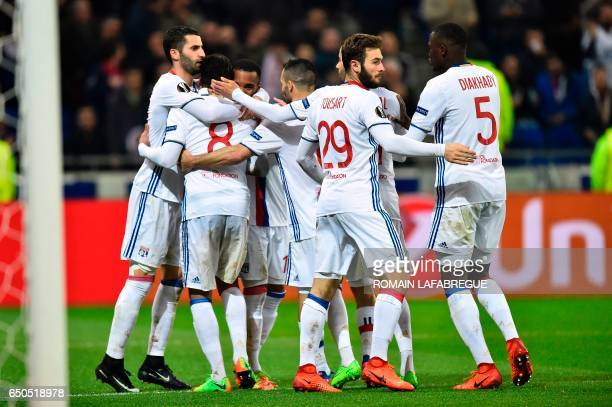 Lyon's players celebrates a goal during the Europa League round of 16 first leg football match between Lyon and AS Roma on March 9 at the Parc...