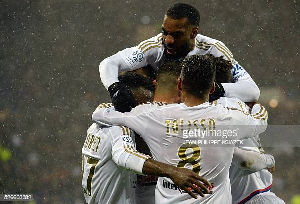 Lyon's players celebrates after scoring a goal during the French L1 football match Lyon vs Ajaccio at the Parc Olympique Lyonnais stadium in...
