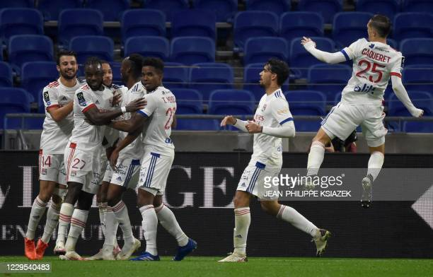 Lyon's players celebrates after scoring during the French L1 football match between Lyon and SaintEtienne on November 8 at the Groupama stadium in...