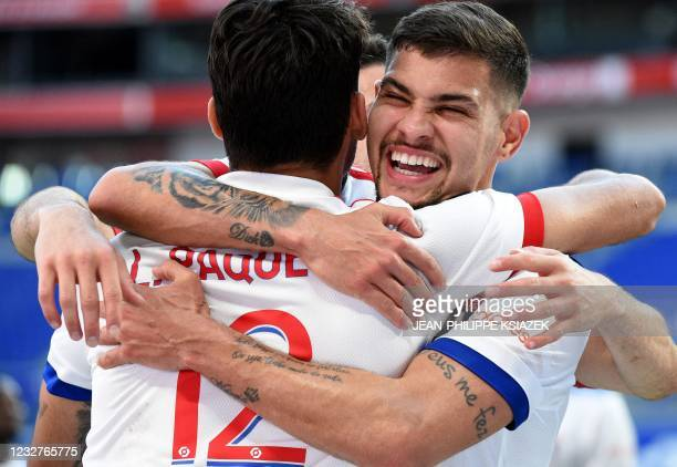 Lyon's players celebrates after scoring during the French L1 football match between Lyon and Lorient on May 8 at the Groupama stadium in...