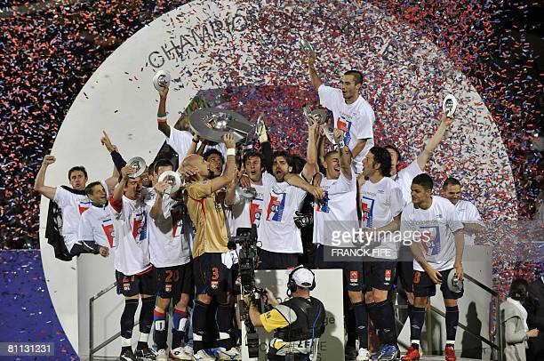 Lyon's players hold the trophy as they celebrate at the end of the French L1 football match Auxerre v Lyon on May 17 2008 at the Abbe Deschamps...