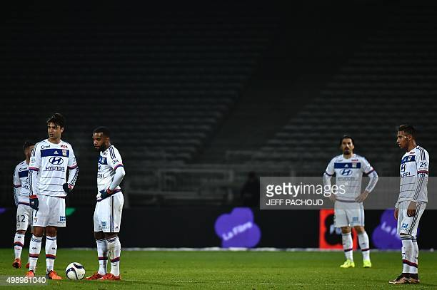 Lyon's players react after Montpellier scored a fourth goal during the French L1 football match between Lyon and Montpellier at the Gerland Stadium...