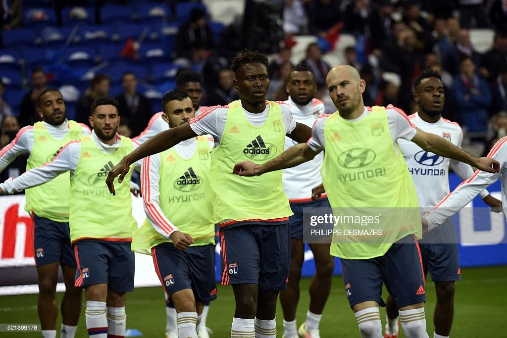 Lyon's players warm up prior to the French L1 football match between Lyon and Nice on April 15, 2016, at the New Stadium in Decines-Charpieu near Lyon, southeastern France.