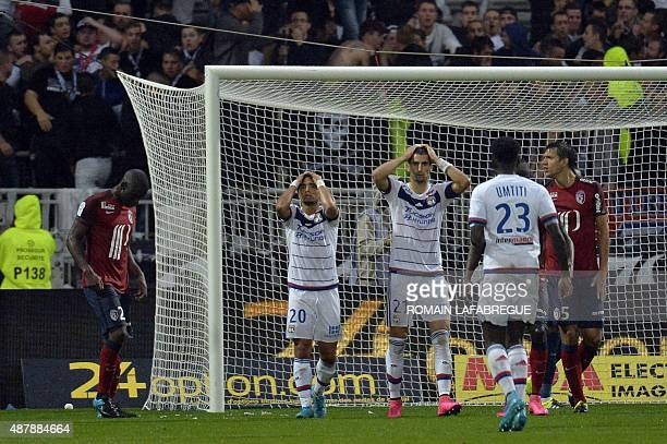 Lyon's Portuguese defender Rafael and Lyon's French midfielder Maxime Gonalons react after a missed goal during the French L1 football match between...